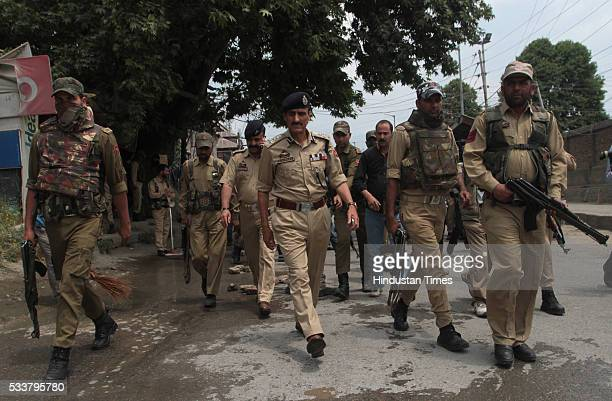 Jammu And Kashmir Policemen patrol the area after two policemen were killed by suspected militants in a shootout in Zadibal in the old part of the...