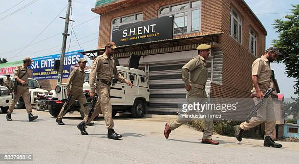 Jammu And Kashmir Policemen patrol the area where two policemen were killed by suspected militants in a shootout in Zadibal in the old part of the...