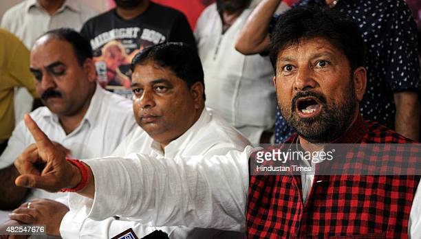Jammu and Kashmir State Health Minister Chaudhary Lal Singh along with BJP MLA Sat Sharma addressing a press conference over AIIMS issue on July 31...