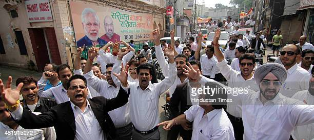 Jammu Bar Association members shout slogans against the state government outside BJP office as they demand AIIMS in Jammu during a Lalkar rally on...