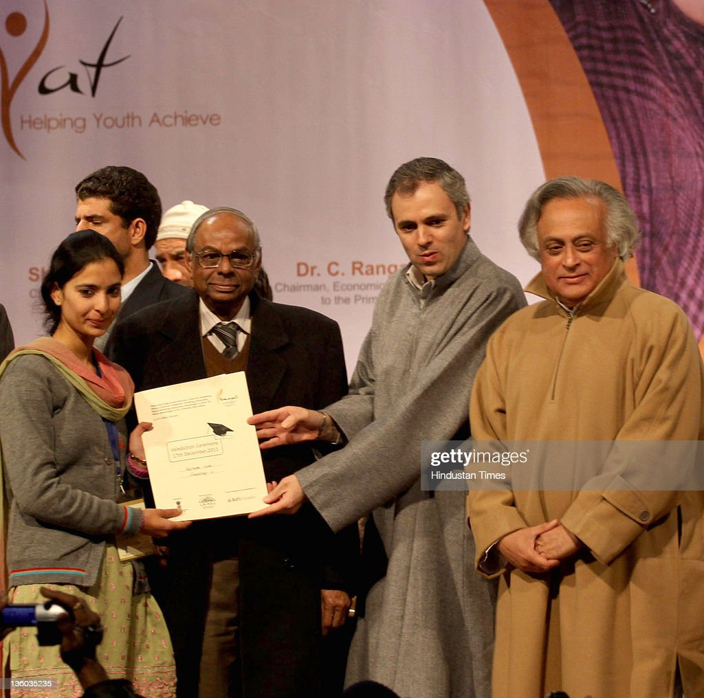 Jammu & Kashmir Chief Minister, Omar Abdullah distributing appointment letters under Himayat project along with Union Rural Development Minister, Jairam Ramesh and C. Rangarajan, chairman, Economic Advisory Council to Prime Minister during a function held on December 17, 2011 in Srinagar, India. The project was launched to provide skill development training to the unemployed youth of Jammu & Kashmir.