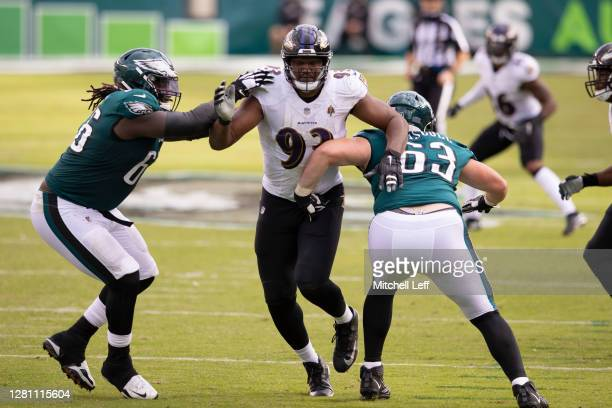 Jamon Brown and Jack Driscoll of the Philadelphia Eagles attempt to block Calais Campbell of the Baltimore Ravens at Lincoln Financial Field on...