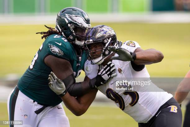 Jamon Brown of the Philadelphia Eagles attempts to block Calais Campbell of the Baltimore Ravens at Lincoln Financial Field on October 18, 2020 in...