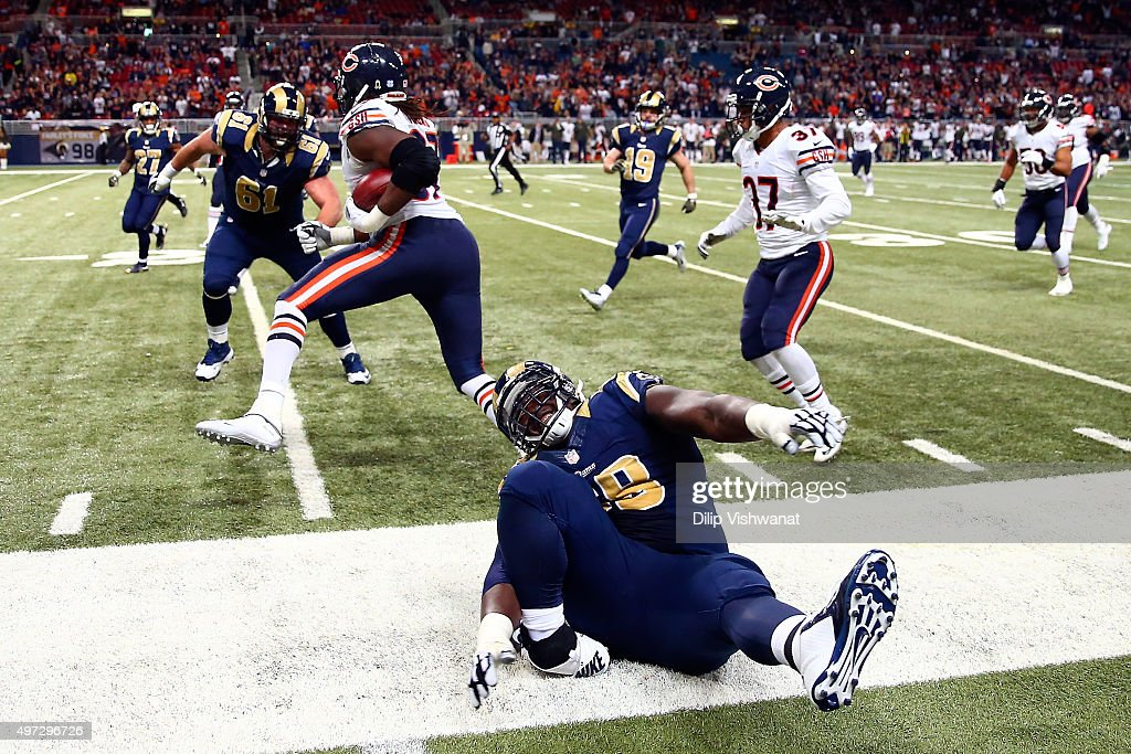 Jamon Brown #68 of the St. Louis Rams injures his ankle while making a play in the fourth quarter against the Chicago Bears at the Edward Jones Dome on November 15, 2015 in St. Louis, Missouri.