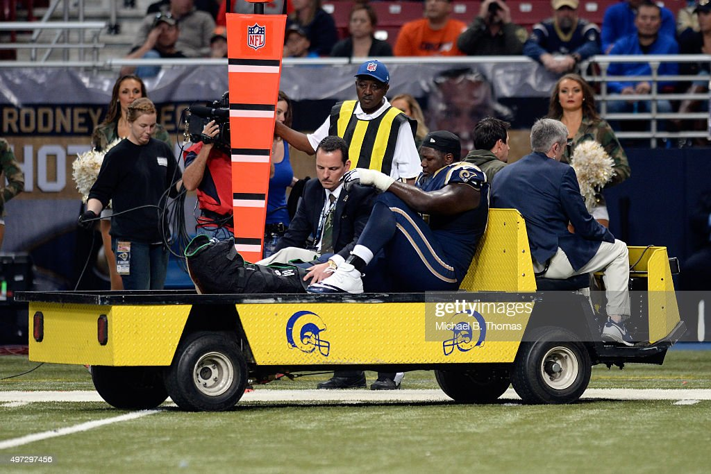 Jamon Brown #68 of the St. Louis Rams is carted off the field after injuring his ankle in the fourth quarter against the Chicago Bears at the Edward Jones Dome on November 15, 2015 in St. Louis, Missouri.