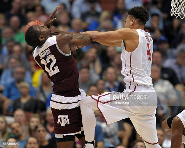 Jamuni McNeace of the Oklahoma Sooners fouls Jalen Jones of the Texas AM Aggies during a shot attempt during the West Regional Semifinal of the 2016...