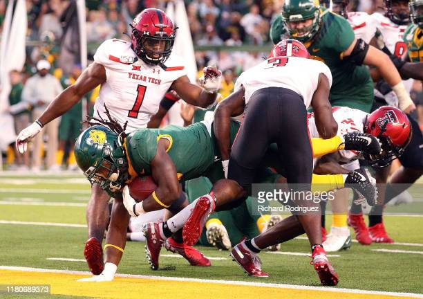 JaMycal Hasty of the Baylor Bears dives into the end zone past Douglas Coleman III of the Texas Tech Red Raiders to score the gamewinning touchdown...