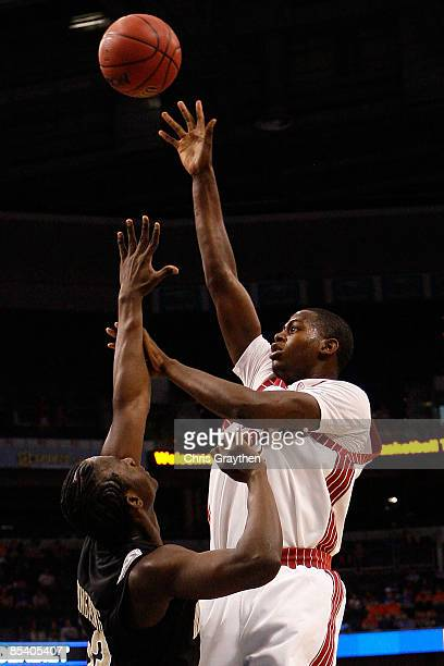 Jamychal Green of the Alabama Crimson Tide makes a shot over Steve Tchiengang of the Vanderbilt Commodores during the first round of the SEC Men's...