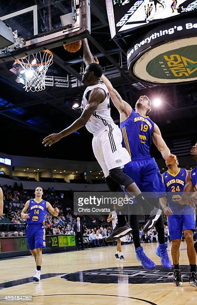 JaMychal Green of the Austin Spurs dunks the ball over Joe Alexander of the Santa Cruz Warriors at the Cedar Park Center on November 23 2014 in Cedar...