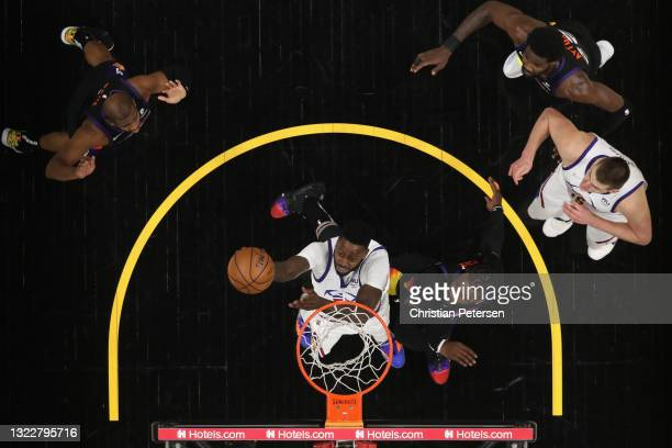 JaMychal Green of the Denver Nuggets lays up a shot past Jae Crowder of the Phoenix Suns during the second half in Game Two of the Western Conference...