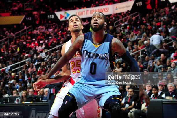 JaMychal Green of the Memphis Grizzlies boxes out against Thabo Sefolosha of the Atlanta Hawks on March 16 2017 at Philips Arena in Atlanta Georgia...