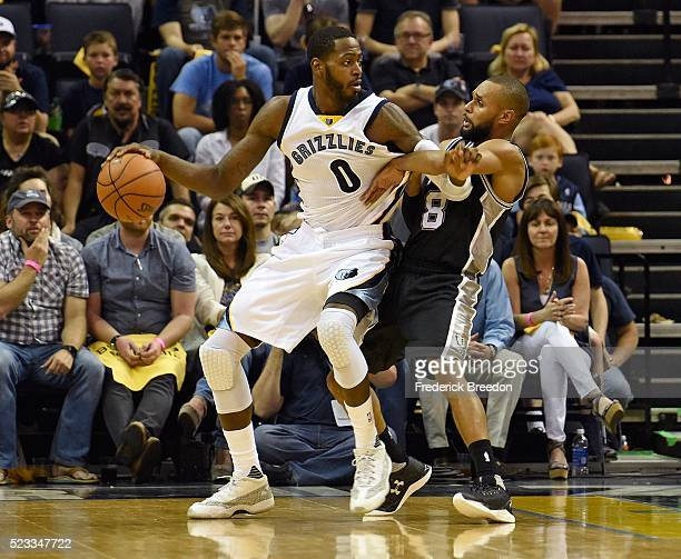 JaMychal Green of the Memphis Grizzlies is defended by Patty Mills of the San Antonio Spurs during the second half of game three of the Western...