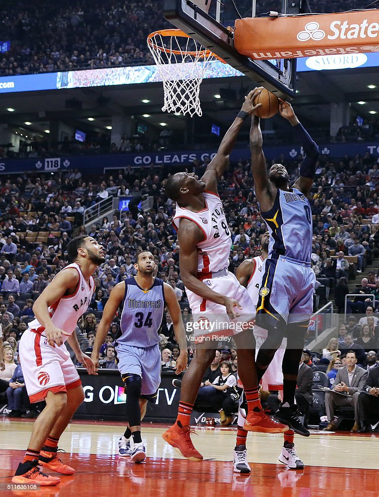 JaMychal Green #0 of the Memphis Grizzlies shoots the ball as Bismack Biyombo #8 of the Toronto Raptors defends during the first half of an NBA game at the Air Canada Centre on February 21, 2016 in Toronto, Ontario, Canada.