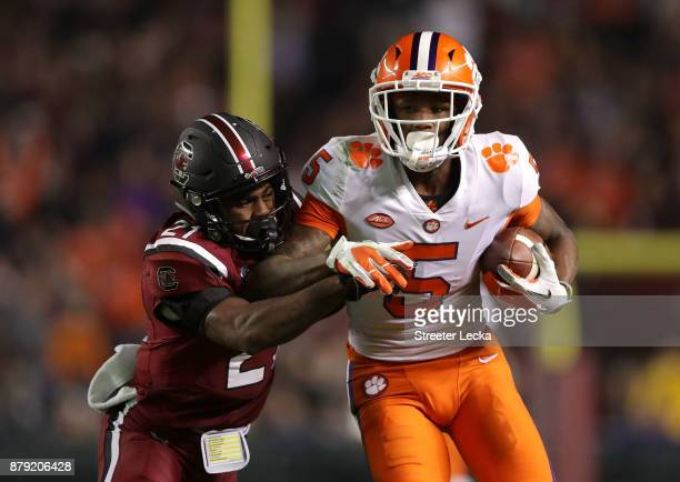 Jamyest Williams of the South Carolina Gamecocks tackles Tee Higgins of the Clemson Tigers during their game at WilliamsBrice Stadium on November 25...