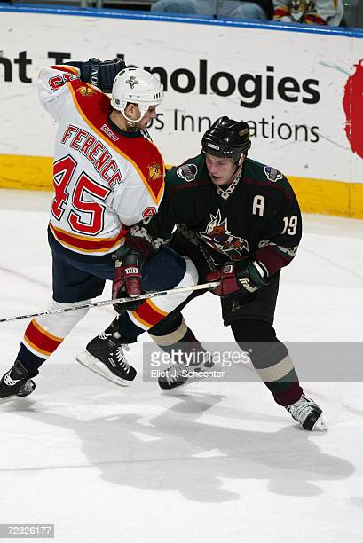 Shane Doan of the Phoenix Coyotes battles Brad Ference of the Florida Panthers during the game at National Car Rental Center in Sunrise Florida The...