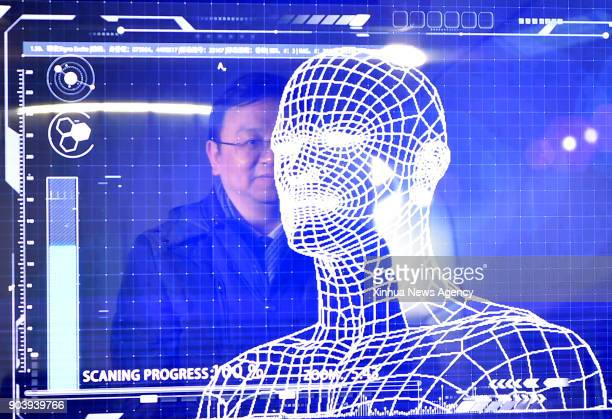YINCHUAN Jan 10 2018 A manager of China's leading new energy vehicle maker BYD tries the facial recognition for starting a 'Yungui' train during the...