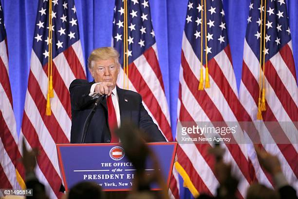 Jan. 11, 2017 -- U.S. President-elect Donald Trump gestures during a news conference in New York, the United States, on Jan. 11, 2017. U.S....
