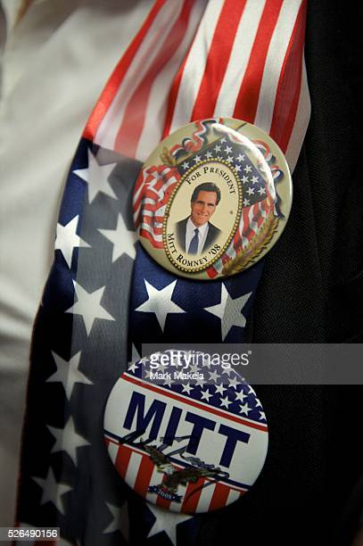 Jan 12 2012 Greer SC USA A supporter of Republican Presidential candidate Mitt Romney wears campagin pins at a grassroots rally at Cherokee Trikes...