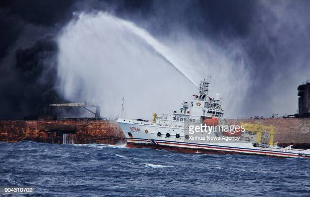 Rescuers spray foam to extinguish flames on the stricken oil tanker SANCHI off the coast of east China's Shanghai Jan 12 2018 Shanghai Maritime...