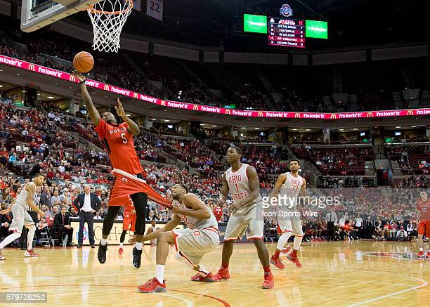 Jan 13 2016 Columbus OH USA Ohio State Buckeyes center Trevor Thompson fouls Rutgers Scarlet Knights guard Mike Williams as he attempts a lay up...