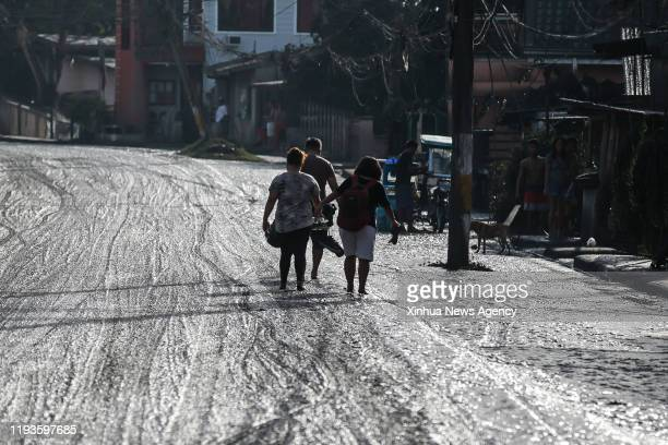 BATANGAS Jan 13 2020 Residents evacuate as the Taal volcano erupts in Batangas Province the Philippines Jan 13 2020 Nearly 50000 people living near a...