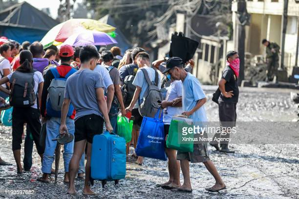 BATANGAS Jan 13 2020 Residents wait for a military truck that will take them to an evacuation center as the Taal volcano erupts in Batangas Province...