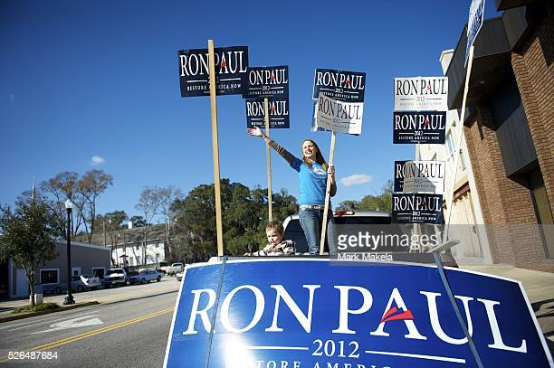 Jan 15 2012 Conway SC USA AMBER NORTH and 1 year old son Eric waive Ron Paul banners across the street from a Republican Presidential candidate Rick...