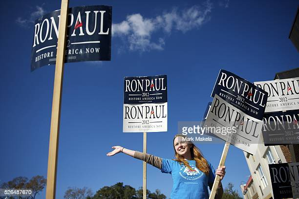 Jan 15 2012 Conway SC USA AMBER NORTH waives Ron Paul banners across the street from a Republican Presidential candidate Rick Santorum event at...