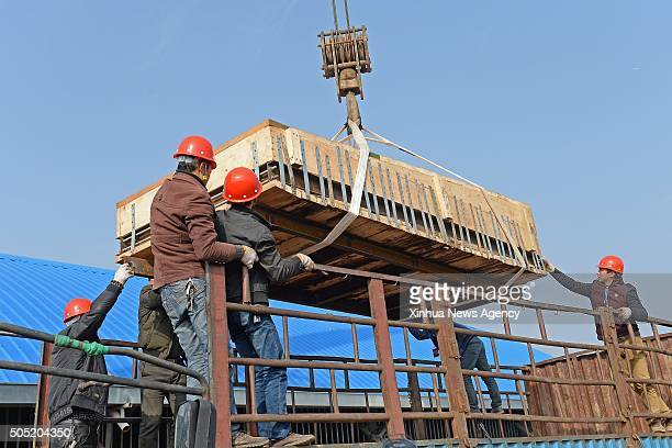 NANCHANG Jan 15 2016 Staff members lift the main coffin in the Haihunhou cemetery east China's Jiangxi Province Jan 15 2016 The main coffin weighing...