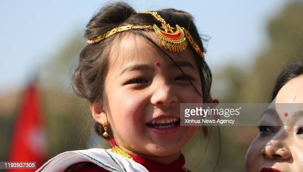 KATHMANDU Jan 15 2020 A girl from Magar community reacts as she takes part in celebrations of Maghe Sankranti festival to mark the beginning of the...