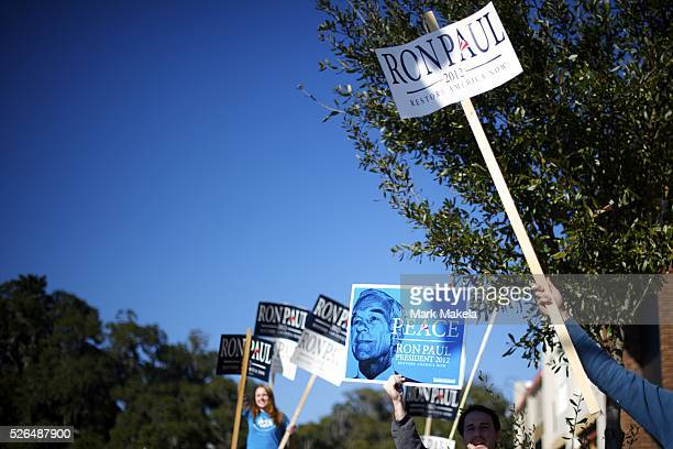 Jan 16 2012 Conway SC USA Ron Paul supporters waive placards across the street from Republican Presidential candidate Rick Santorum's hosting of a...