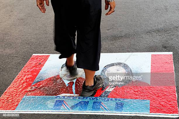 Jan. 19, 2014 - Bangkok, Thailand. On this poster is an image of the exiled former PM Thaksin and the current PM, his youngest sister, Yingluck stuck...
