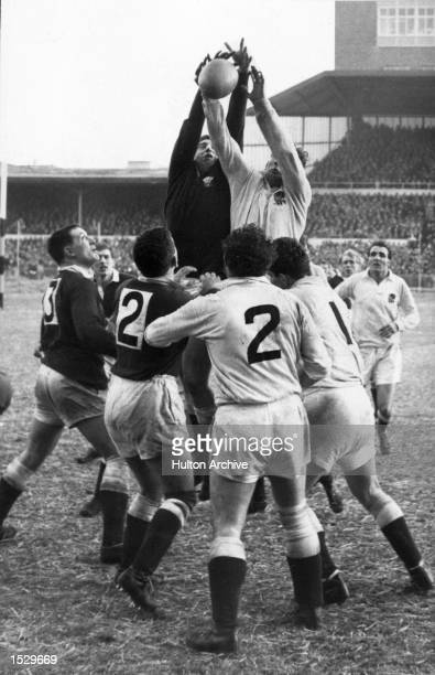 England beat Wales 136 at Cardiff Welshman Bryan Price rises with Englands J Owen in a lineout during the rugby match at the Arms Park Mandatory...