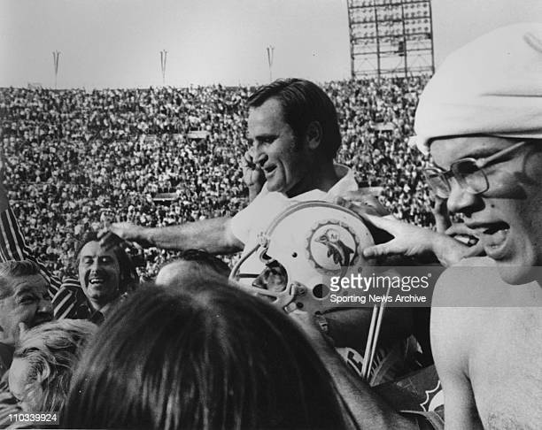 Coach Don Shula of the Miami Dolphins is carried off the field by Nick Buoniconti after defeating the Washington Redskins 147 at the Los Angeles...