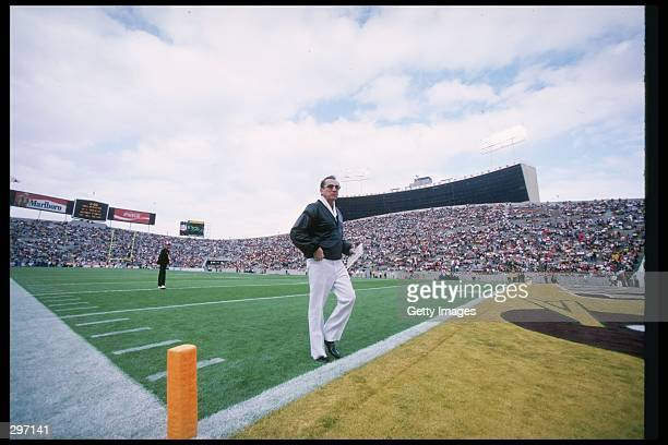 Los Angeles Raiders owner Al Davis walks off the field during Super Bowl XVIII against the Washington Redskins at Tampa Stadium in Tampa Florida The...