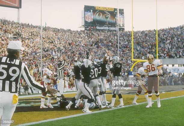 The Los Angeles Raiders celebrate a touchdown against the Washington Redskins in Super Bowl XVIII at Tampa Stadium in Tampa Florida The Raiders won...