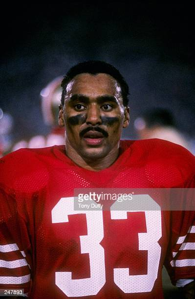 Running back Roger Craig of the San Francisco 49ers stands on the field during Super Bowl XIX against the Miami Dolphins at Stanford Stadium in...