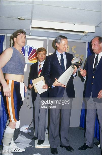 NFL Commissioner Pete Rozelle presents the Vince Lombardi trophy to owner Michael McCaskey and quarterback Jim McMahon of the Chicago Bears after the...
