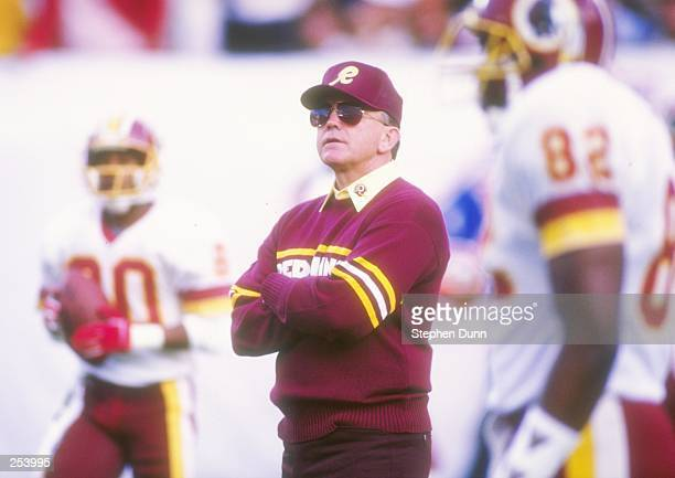 Joe Gibbs head coach of the Washington Redskins watches the game closely during Super Bowl XXII against the Denver Broncos at Jack Murphy Stadium in...
