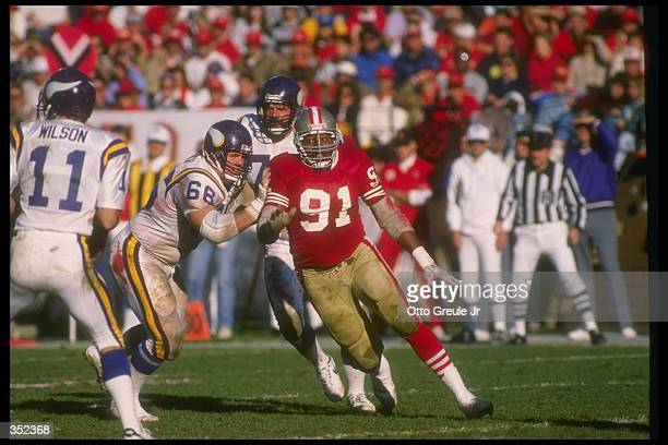 Defensive lineman Larry Roberts of the San Francisco 49ers works against the Minnesota Vikings during a playoff game at Candlestick Park in San...