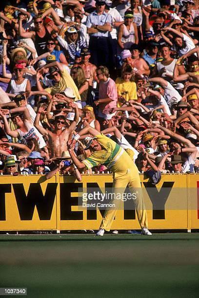 Merv Hughes of Australia warms up the crowd during the Benson Hedges World Series Final against the West Indies at the MCG in Melbourne Australia...