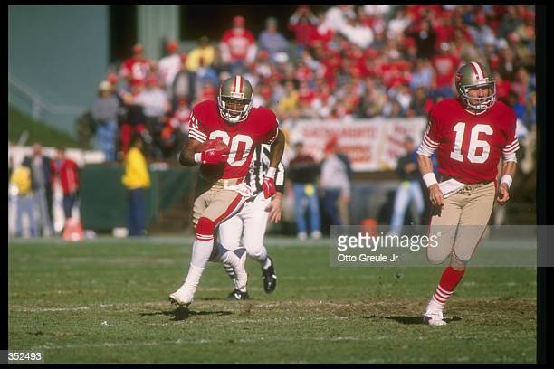 Quarterback Joe Montana of the San Francisco 49ers blocks for wide receiver Jerry Rice during a playoff game against the Minnesota Vikings at...