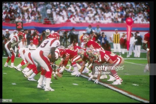 Quarterback Joe Montana of the San Francisco 49ers calls the signals during Super Bowl XXIII against the Cincinnati Bengals at the Joe Robbie Stadium...