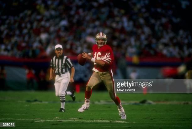 Quarterback Joe Montana of the San Francisco 49ers looks to pass the ball during Super Bowl XXIII against the Cincinnati Bengals at Joe Robbie...