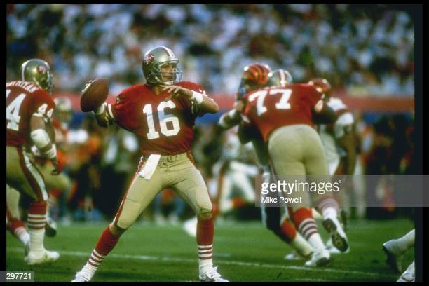 Quarterback Joe Montana of the San Francisco 49ers wants to pass during the Super Bowl XXIII game at the Joe Robbie Stadium in Miami Florida The...