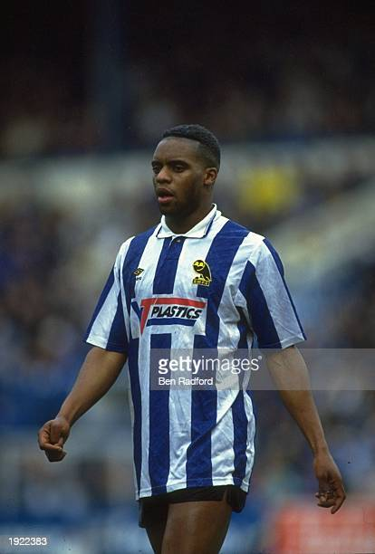 Dalian Atkinson of Sheffield Wednesday walks up the pitch during the FA Cup fourth round match against Everton at the Hillsborough Stadium in...