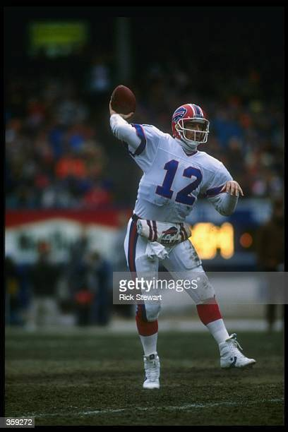 Quarterback Jim Kelly of the Buffalo Bills passes the ball during a playoff game against the Cleveland Browns at Cleveland Stadium in Cleveland Ohio...