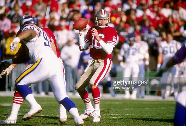 Quarterback Joe Montana of the San Francisco 49ers drops back to pass during a playoff game against the Minnesota Vikings at Candlestick Park in San...