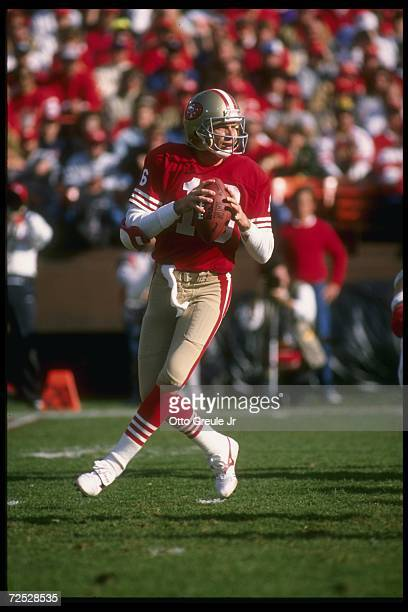 Quarterback Joe Montana of the San Francisco 49ers scans the defense for an open receiver as he drops back to pass during a play in a 49ers 4113...