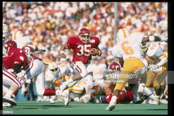 Running back James Rouse of the Arkansas Razorbacks runs down the field during the Cotton Bowl against the Tennessee Volunteers in Dallas, Texas....